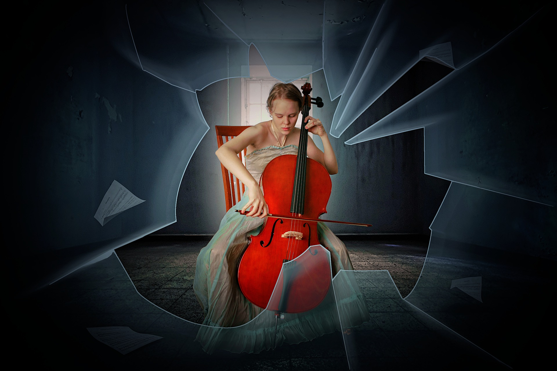 women playing cello in chair